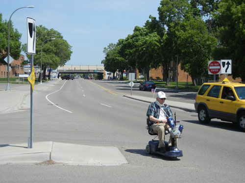 Senior-motorized-wheelchair-in-street-WEB