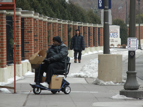 2-men-walking-motorized-wheelchair-saint-paul-WEB